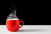 Steaming Coffee Cup On Black B...