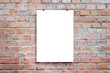 Leinwanddruck Bild - Poster design presentation mockup. Blank paper poster hanging attached with clips across brick wall