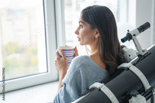 Peaceful astronomer is drinking tea stock photo Wallpaper Mural