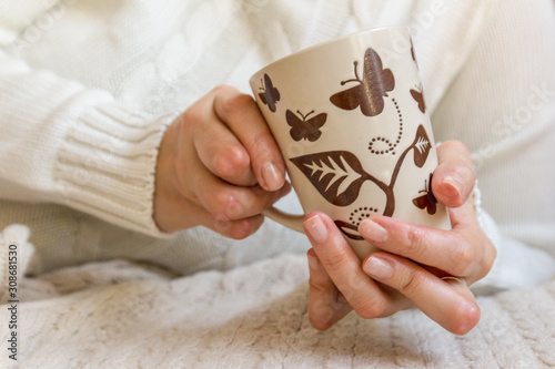 Young woman having rheumatoid arthritis is holding a cup of tea Canvas Print