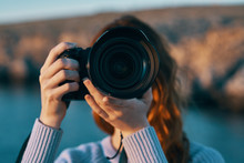 Woman Taking Photo With Digital Camera