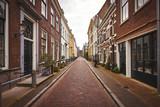 Fototapeta Uliczki - Empty street in the historical district of Utrecht
