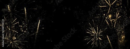 Goldenes Feuerwerk auf schwarzem Hintergrund-abstrakter Hintergrund, Banner für Fototapeta