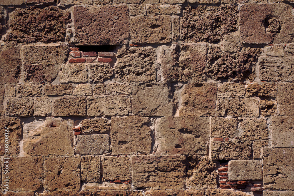 Old medieval brick wall surface. Brick wall texture. Antique wall background.