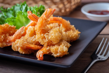 Fried shrimp and vegetable on plate