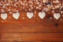 Eco Linen Fabric Hearts On Wooden Bokeh Background, Valentines Day Concept Design.Decorative White Heart On Jute Twine Garland,natural Retro Burlap String. Hand Made Decorations For Lovers Day,flatlay