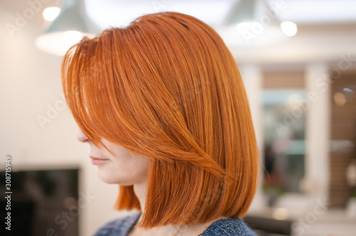Carta da parati Portrait of a woman with bright red hair