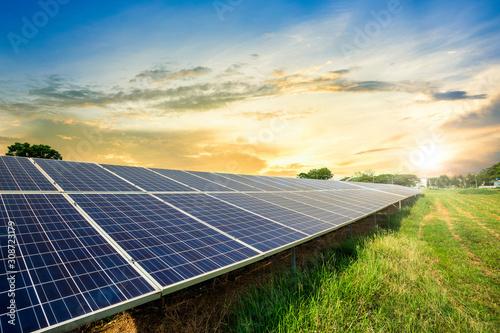 Obraz Solar panel cell on dramatic sunset sky background,clean Alternative power energy concept. - fototapety do salonu