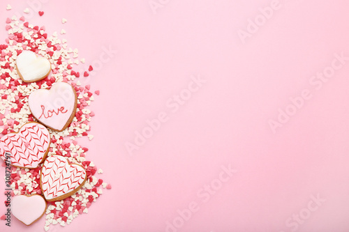 Valentine day cookies with heart shaped sprinkles on pink background Wallpaper Mural