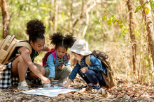 Group Family Children Checking Map For Explore And Find Directions In The Camping Jungle Nature And Adventure. Tourism Kids Travel For Destination And Leisure Trips For Education And Relax In Nature
