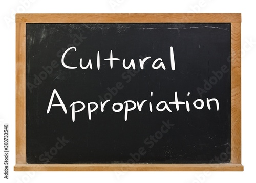 Photo Cultural Appropriation written in white chalk on a black chalkboard isolated on