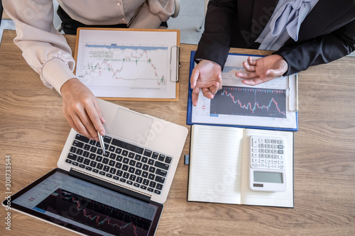 Fototapeta Businesswoman on meeting conversation and collaboration discussing of partner cooperation to planning in investment trading marketing project to investor of deal a stock exchange to business profit obraz