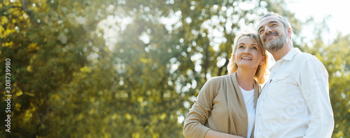 Fototapeta Senior Caucasian couple hugging in park. Family with a happy smile feels relaxed with nature in the morning. Or in the evening. Enter  elderly society And retire from work. Concept health insurance obraz