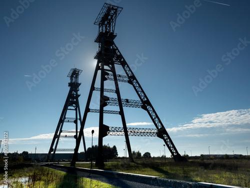 Fototapeta old lift shafts of closed coal mine in backlight