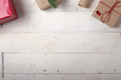 Christmas gifts placed on white wooden table in vintage style with copy space