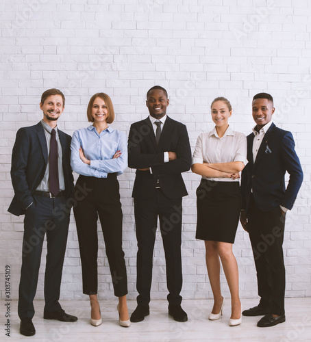 Friendly diverse business team smiling at camera