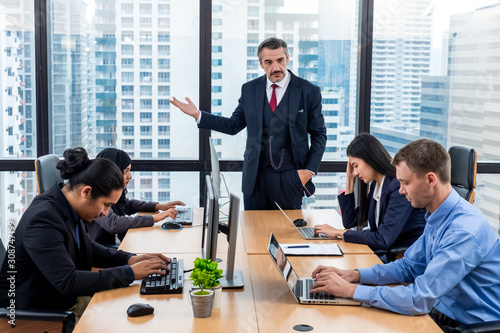 Moody or angry boss complaining team about mistake in workplace concept. Businessman managers pointing out mistake to his team. Toxic work environment concept