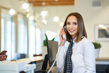 Receptionist Answering Phone A...