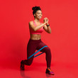 canvas print picture - Cheerful afro fitness girl making working out with resistance band