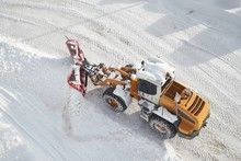 Snow Plow Machine Clearing Snow From Roads After Heavy Snowfall In The Alps