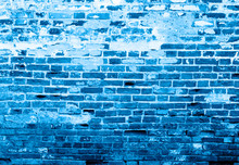 The Concrete Surface With A Large Stone And Old Brick Toned In Blue