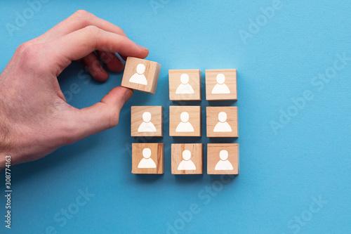 Fototapeta Hand adding a new team member to a group