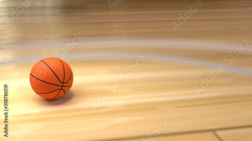 Photo Basketball on Court Floor close up with blurred arena in background with copyspace