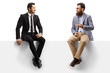 canvas print picture - Man in a suit and a bearded man sitting on a blank panel and talking