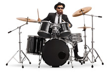 Man In A Suit Playing Drums