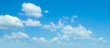Fluffy Clouds In Blue Sky. Bac...