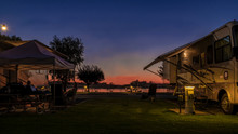 Long Exposure Photo At A Rv Park During A Sunset On The Delta In Rio Vista Ca. With People Enjoying The Evening