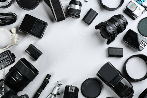 Fototapeta Frame made of equipment for professional photographer on white background, flat lay. Space for text obraz