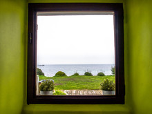 Sea View From A Window In A Gr...
