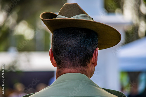 Close-up contemplative Australian Army soldier wearing Slouch Hat during ANZAC D Wallpaper Mural