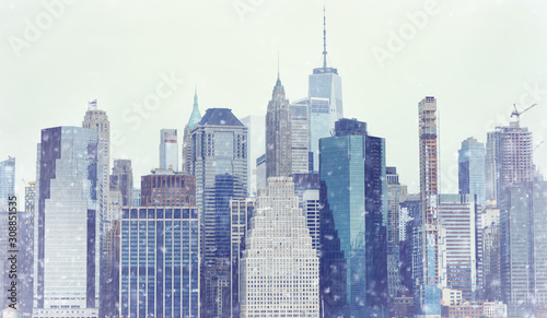 toned-photo-new-york-city-manhattan-downtown-skyline-at-winter-day-during-snowfall