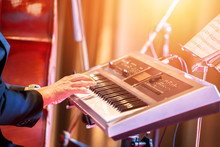 People Play Keyboard Music On Stage.