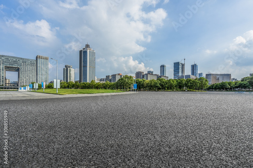 Poster Gris empty concrete floor and cityscape in blue cloud sky