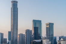 Aerial Sunset Panorama View Of Tel Aviv Financial District, Givatayim, , Givat Amal, Tel Binyamin, Givat Rambam, Montefiore With Skyscrapers And Cranes Working On New Construction In Israel