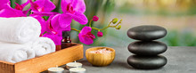 Hot Spa Stones Set For Massage Treatment, Orchid Flower, Towels, Candles And Sea Salt On Green Background With Bamboo. Elegant And Luxury Spa. Mock Up, Template. Health And Beauty Care Concept