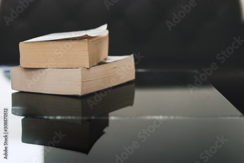Fototapeta Stack of books on wooden table with copy space. Education background. Back to school concept obraz na płótnie