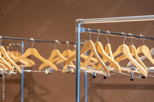 Wooden coat hangers on coat rack with no clothes in cloakroom Canvas-taulu