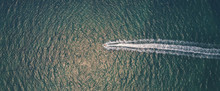Aerial View Of People Having Fun On Jet Ski, Recreational Summer Holidays Travel, Water Sport, Freedom Direction And Outdoor Adventure Concept, Drone Above View