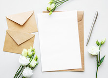 White Eustoma Flowers And Envelopes