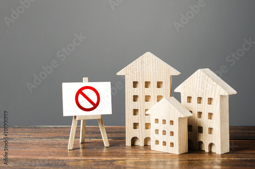 Figures of residential buildings and red prohibition sign no Canvas-taulu