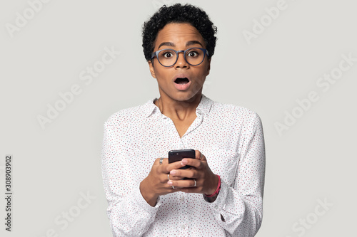 Head shot baffled black girl received sms with unexpected news. Canvas Print