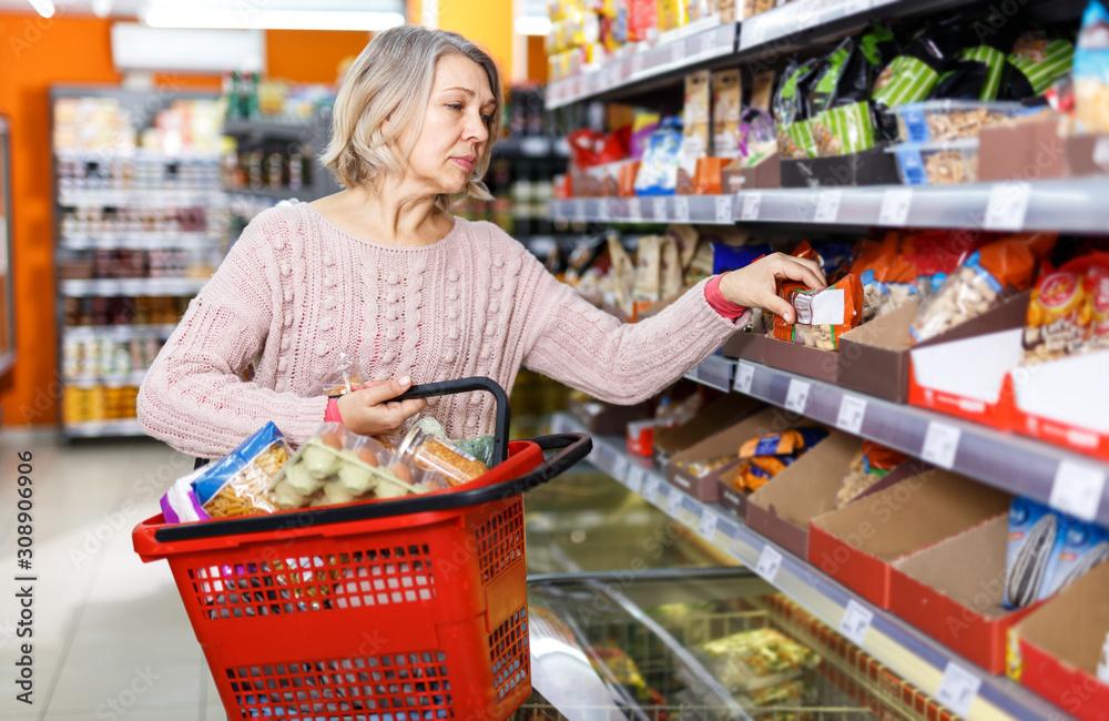 Fototapeta Mature woman shopping in supermarket