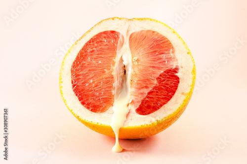 Photo Sexy grapefruit with sperm, erotic concept