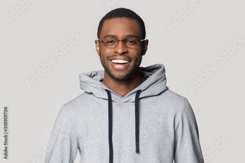 Smiling black male student in stylish hoodie looking at camera. Wallpaper Mural
