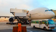Closeup high detailed view of refueling operation of large widebody passenger aircraft standing on airport's parking place at ground maintenance. Dubai morning dawn
