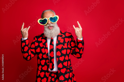 Photo Photo of funky aged man amour cupid character role showing horns fingers excited
